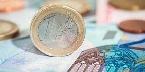 Euro-Münze und Geldschein